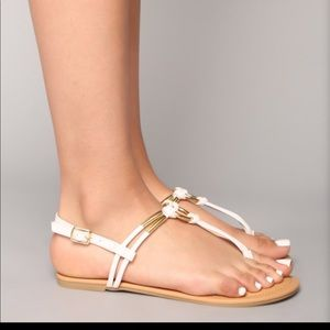 Barley worn white sandals